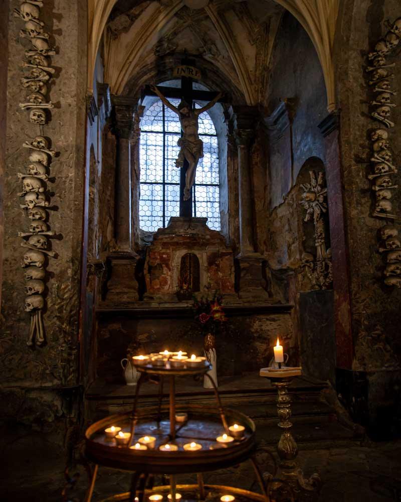 Candles light up an underground chapel