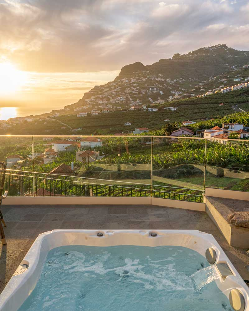 The hot tub looking out at green mountains in Madeira at Quinta da Saraiba