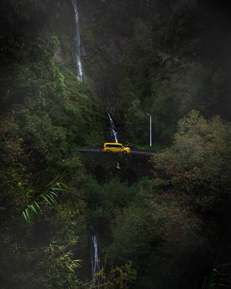 A yellow taxi in a waterfall at Madeira