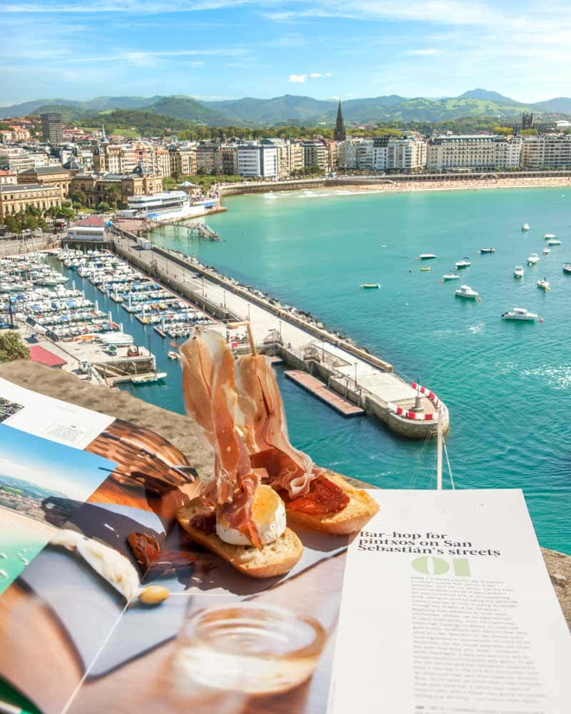 Views over the harbour in San Sebastian with pinxtos in the foreground