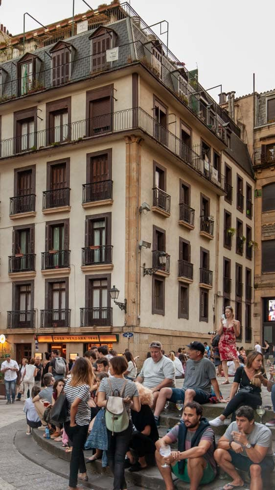 People gather in a square for drinks in the Basque Country