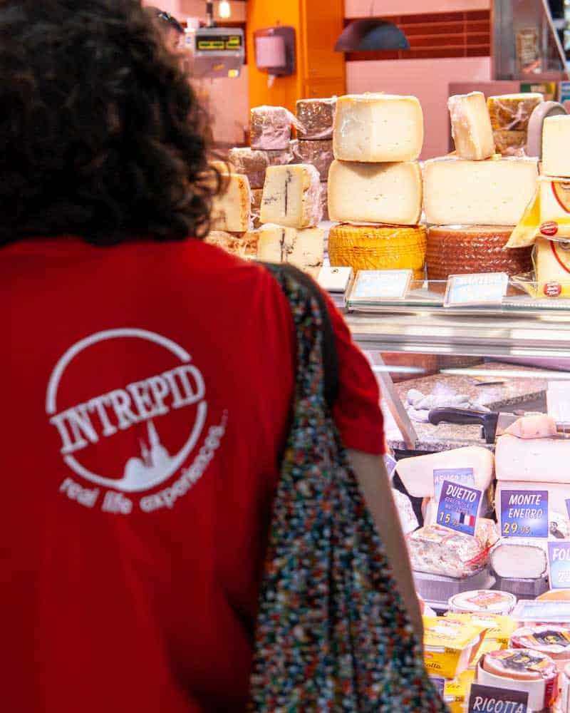 Woman in front of cheese in San Sebastian